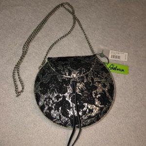 Sam Edelman small cross body purse.  Silver/black